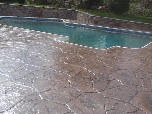 sealing-stamped-concrete-pool-patio-west-greenwich-ma-1239x929